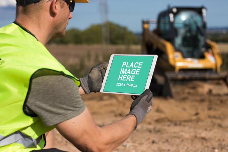 Construction man holding iPad