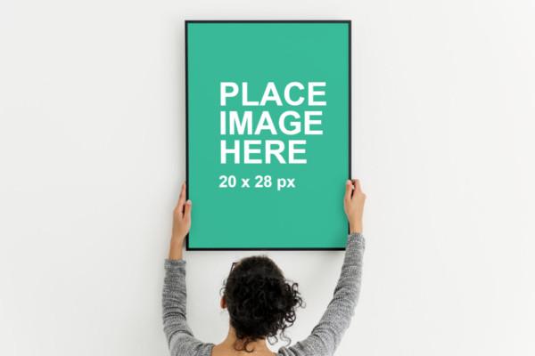 Woman holding black frame