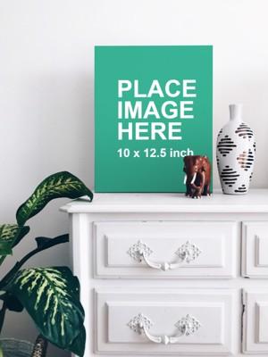 Poster on white dresser