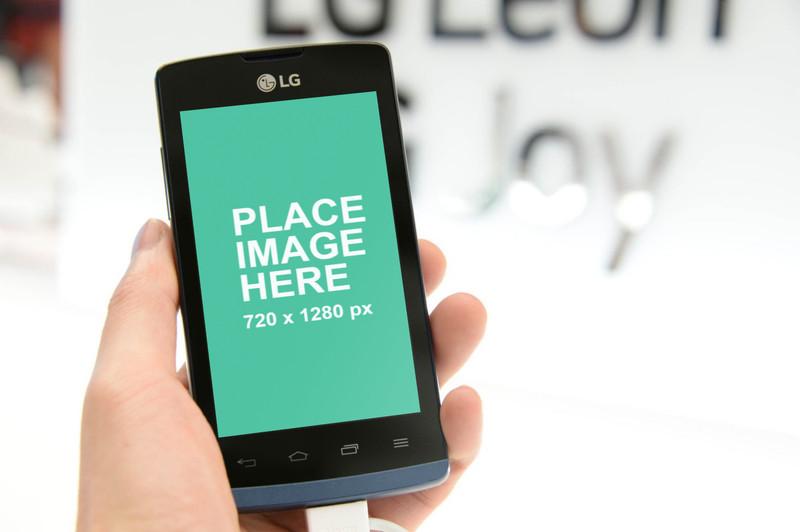 Man holding LG phone