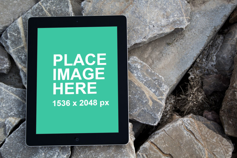 Black iPad 4 on rocks with front view