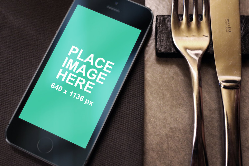 Black iPhone 5s with fork