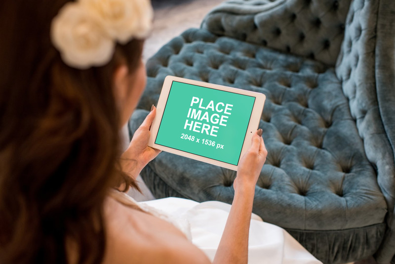 Bride holding white iPad