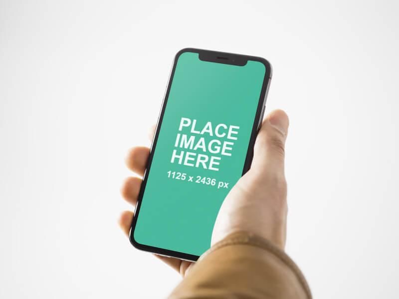 Man holding an iPhone X