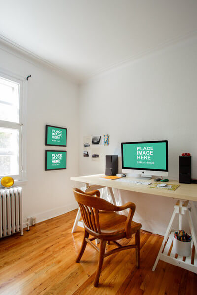 iMac in home office with picture frames