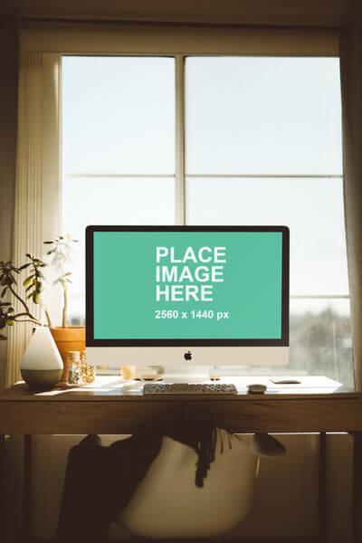 iMac on wood desk with natural light