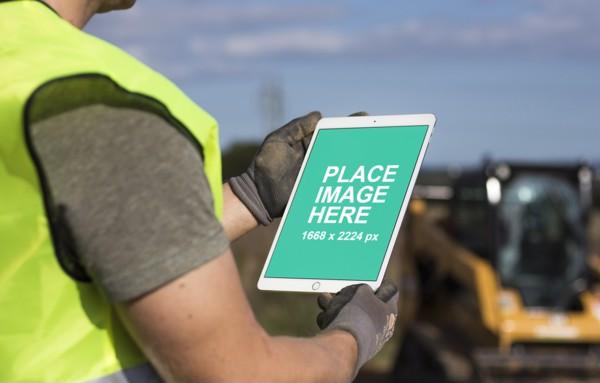 Construction worker using iPad Pro