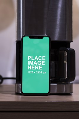 iPhone X with coffee machine