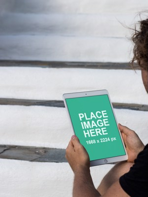 Man holding iPad Pro