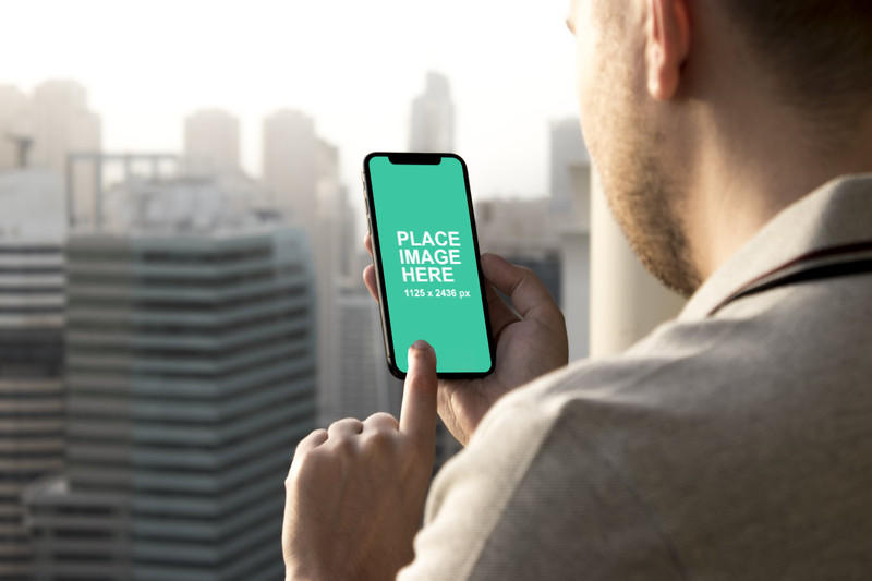 Man using black iPhone X mockup
