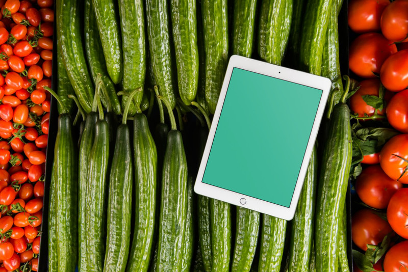 iPad on bed of vegetables