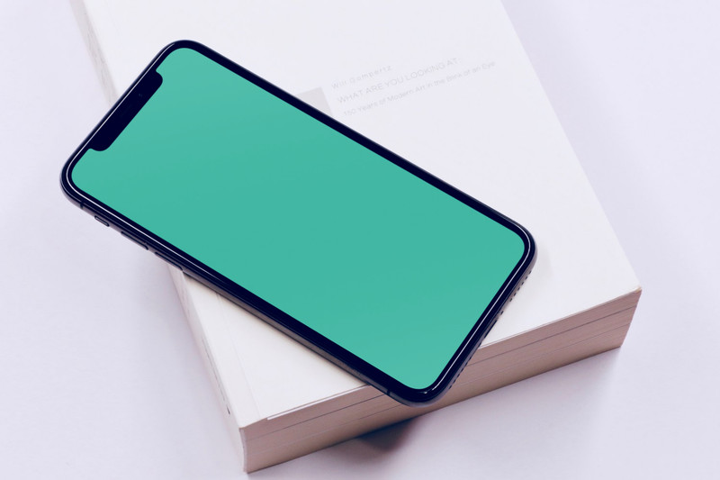 iPhone X on book