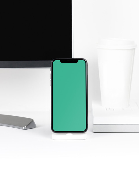 iPhone X on white desk