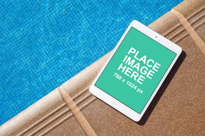 White iPad mini at pool side