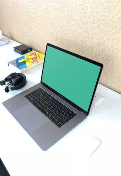 MacBook Pro on white desk