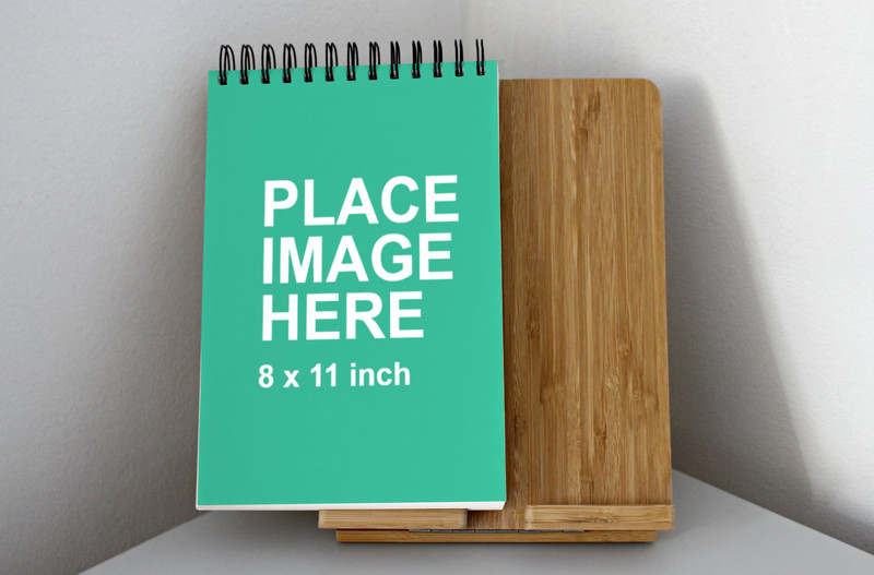 Paper notebook on wooden board