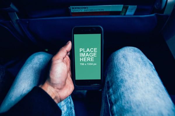 Black iPhone in plane