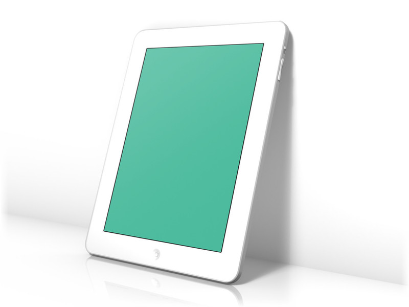White iPad leaning on wall
