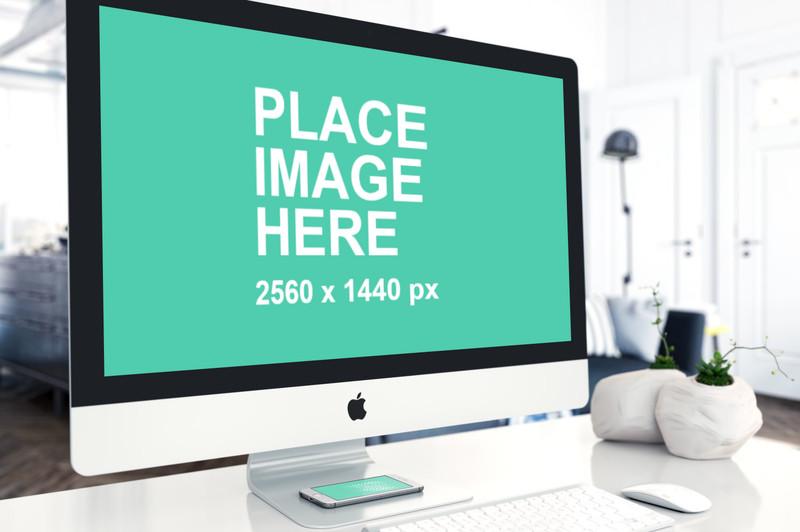 Closeup right facing iMac and iPhone