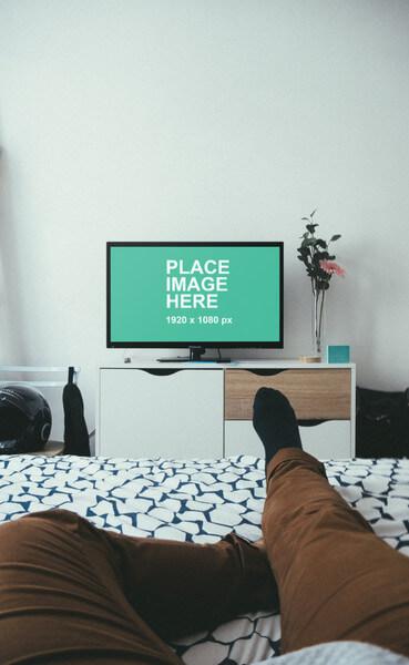 Watching TV in bedroom