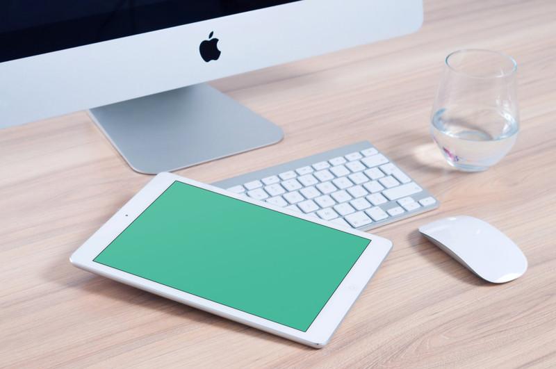 White iPad and iMac on desk