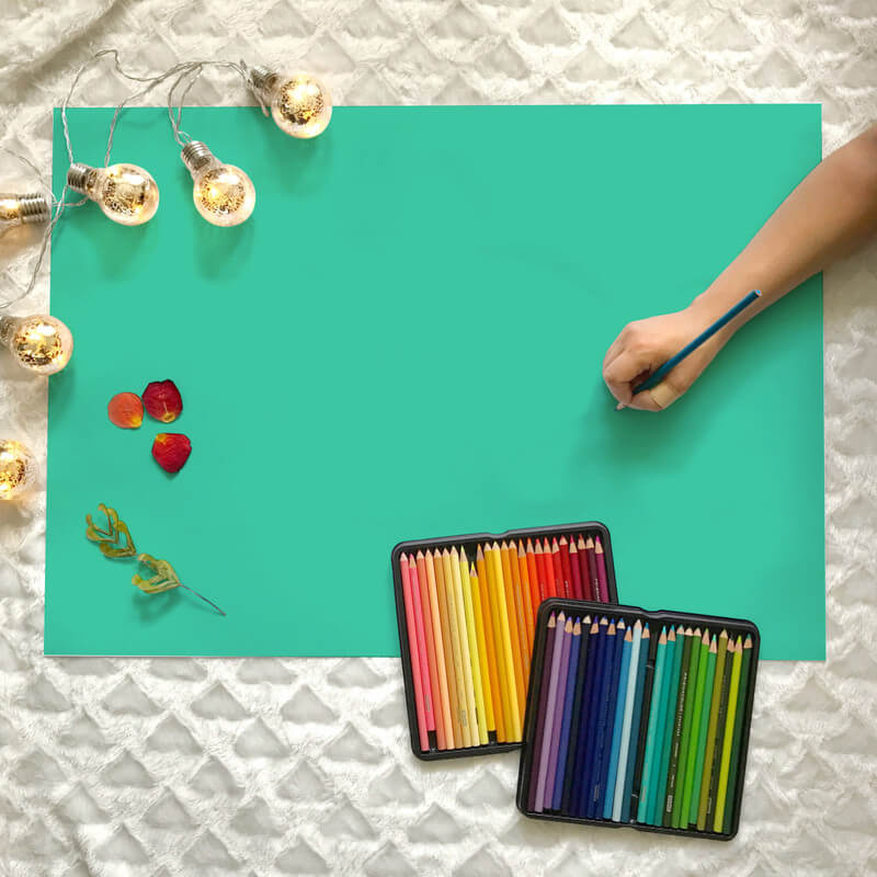 Woman Drawing with Colored Pencils on B2 Large Poster Flatlay Mockup