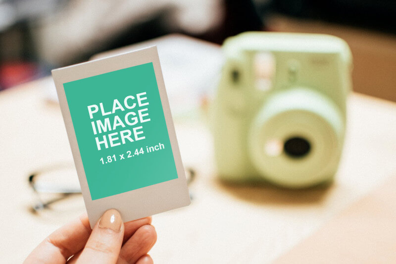 Woman holding Instant photo