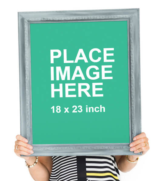 Woman holding large picture frame